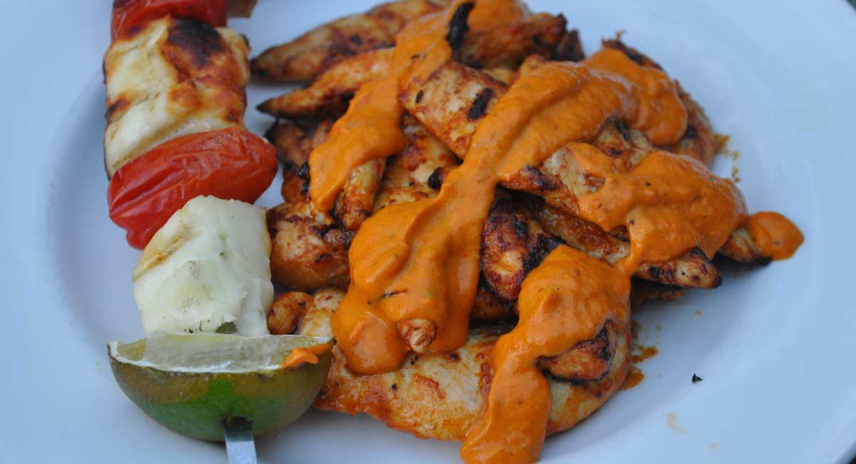 Chicken goujons with roasted pepper sauce