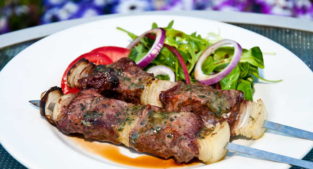 Steak kebabs with garlic butter